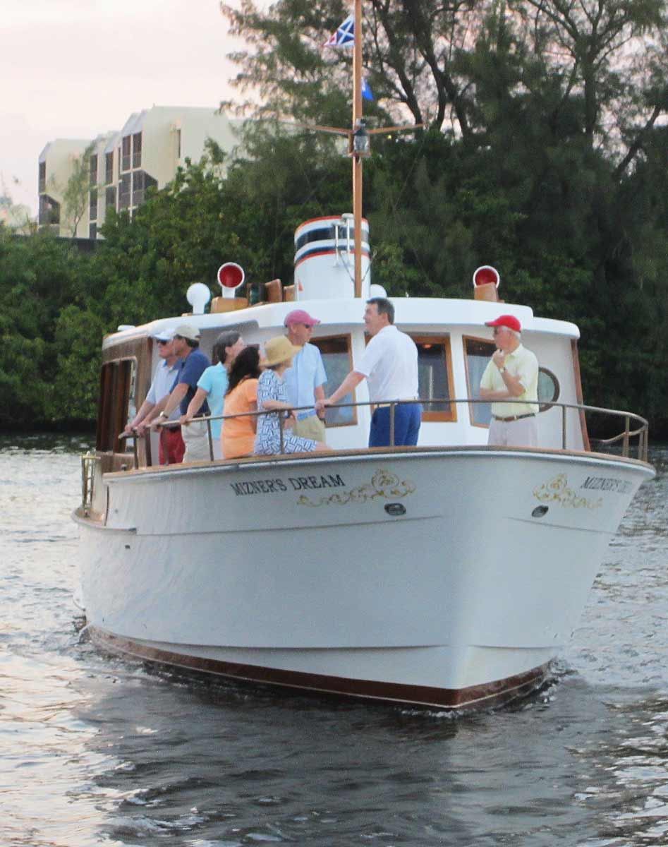 Group of guests gathered at the bow of yacht charter Mizner's Dream