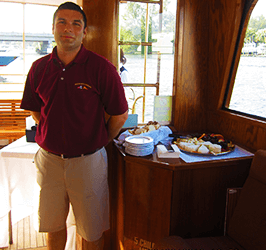 Captain welcoming guests aboard Mizner's Dream charter yacht